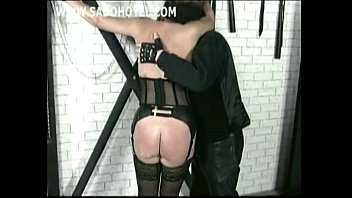 Horny older slave with clamps and heavy weights on her pussy got spanked on her ass by her master