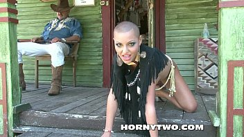 Bald head and bald pussy of Halloween cowgirl posing the pretty cunt