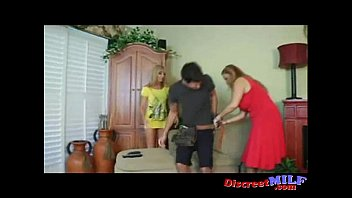 Young guy gets handjobed by two busty MILFs
