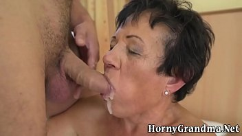 elderly nymph gets jizz facial cumshot