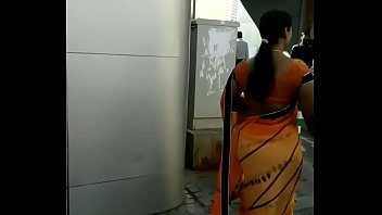 low hip saree and open back.