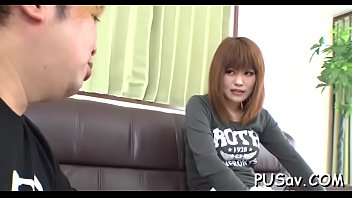 japanese muff gets finger nailed as she munches.
