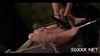 Roped playgirl relishes being forcefully permeated by stud