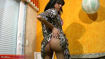 Black haired tranny on heels strips pink lingerie and jerks