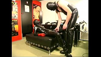 ultra-kinky marionette female liking a strap.