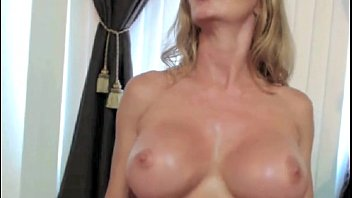 silver-blonde cougar demonstrates off pec muscles on webcam.